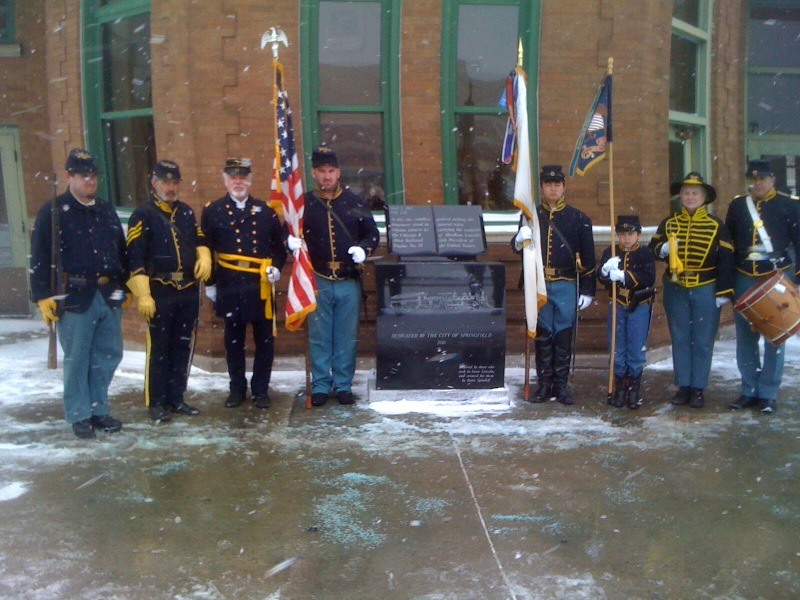 The 10th Cavalry presents the Colors at the Amtrak Depot in Springfield, February 2010, for the Funeral train monument.